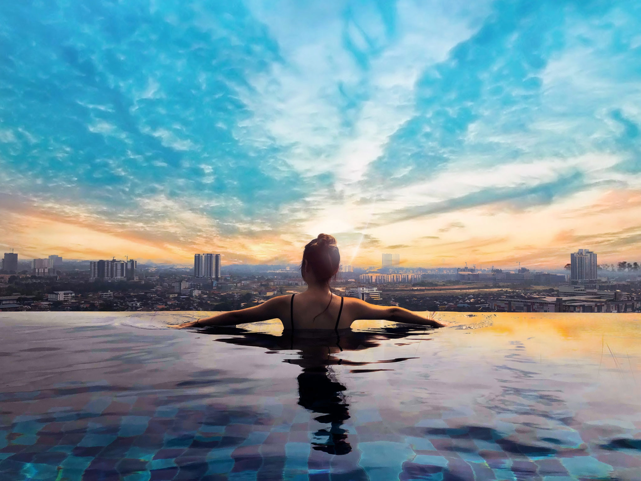 Boutique hotels rooftop pool sunset view - TWISPER lists
